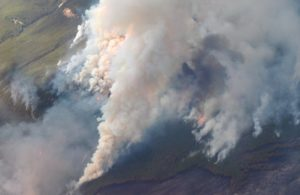 https://commons.wikimedia.org/wiki/File:Aerial_view_of_a_forest_fire_in_Saskatchewan_-b.jpg