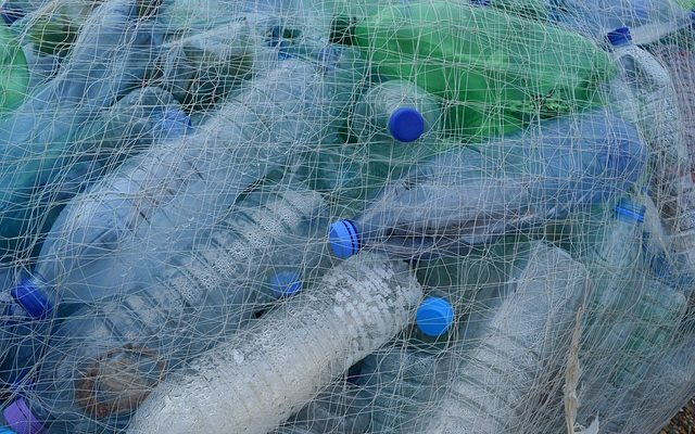 https://pixabay.com/en/plastic-bottles-fishing-net-netting-388679/